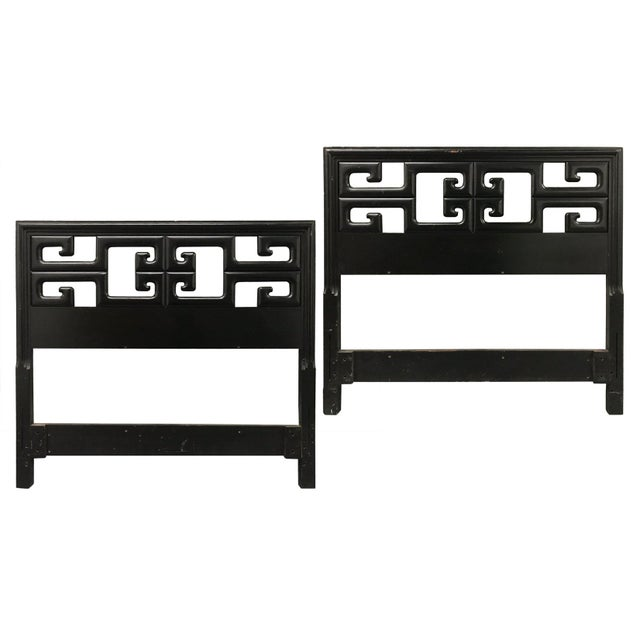 Striking pair of vintage twin-sized headboards. Original black lacquer finish. Hand carved Greek key design. Designed for...