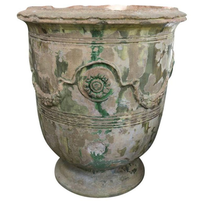 Patina of age is worn well through the green and brown glaze on this pair of Anduze Jars. They are very large standing at...
