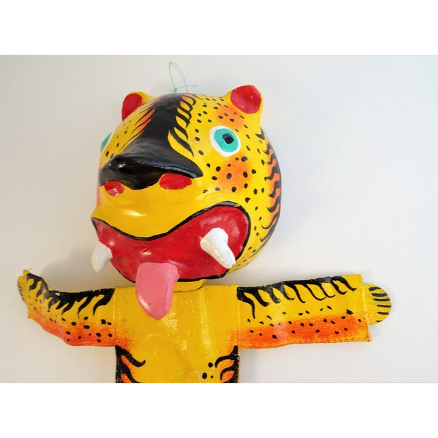 This hand painted tiger sculpture is a stunning bright piece. The head is made out of a coconut shell, and type of mud...