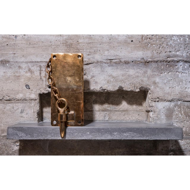 Spanish Colonial-style gate latch, in two-tone gold and bronze. Handy key pin, attached to a chain, secures the gate to...