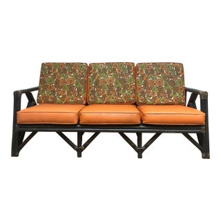 Mid Century Rattan Sofa With Vintage Vinyl Floral Cushions For Sale