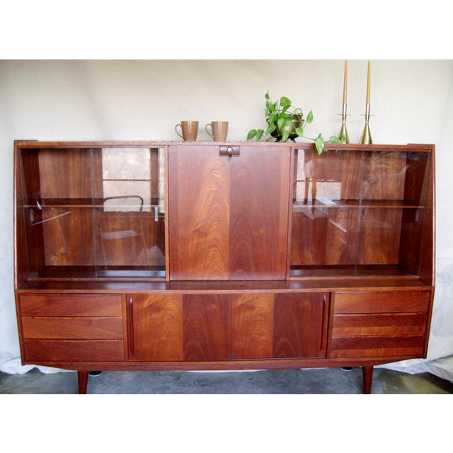 This mid-century modern credenza / hutch is a versatile piece that would be equally at home as a desk and storage or dry...