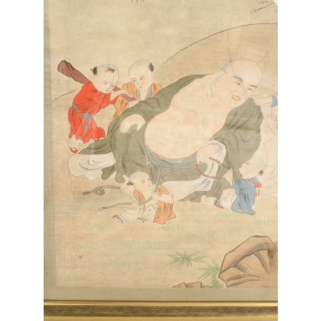 Asian Chinese style (19th Cent) watercolor portrait on paper of fat seated figure surrounded by 6 children in a gilt frame