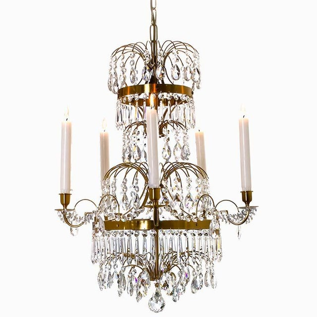 A Gustavian crystal chandelier in classical twentieth-century style with a typical Scandinavian design. The chandelier has...