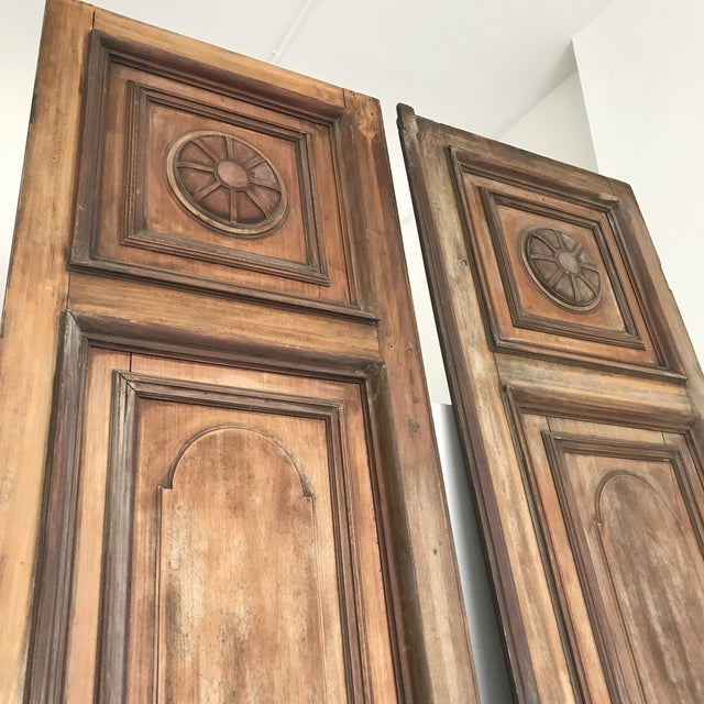 These 10 foot tall antique solid mahogany doors came from New Orleans, as  found. - Antique Mahogany Tall Embellished Doors - A Pair Chairish