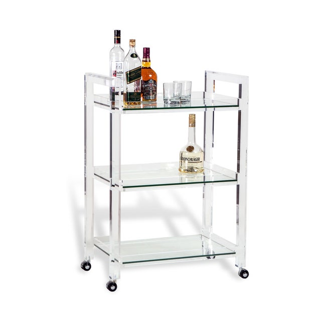 Setting the tone for the party, the acrylic and glass Ava Bar Cart pairs clean, simple lines with a fresh, mod vibe. Allow...