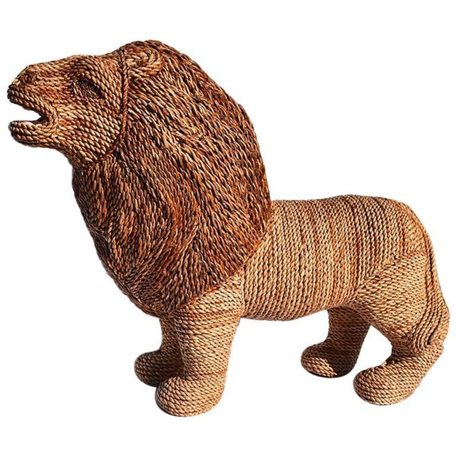 Large raffia or wicker woven animal figure of a Lion. This piece would make a lovely statement to any space. We especially...