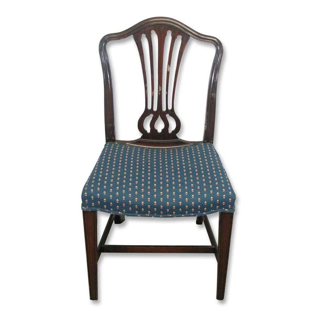 Five fine dining chairs in mahogany with blue cushioned seats. Priced as a set.