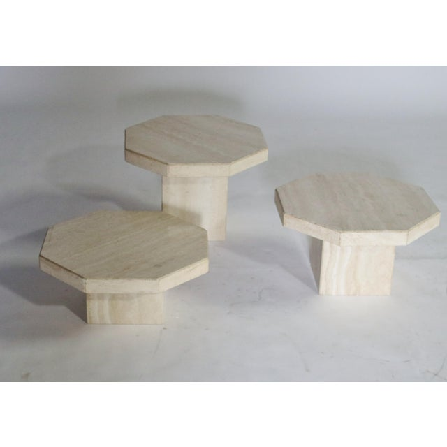 1970's trio of Travertine tables in various heights and removable hexagon-shape tops. Can be used as a cluster of cocktail...
