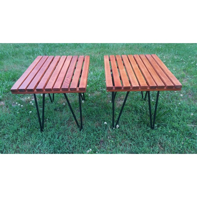 A rare pair of Pipsan Saarinen-Swanson slatted side tables. Table slats have been restored to an original rusty brown...
