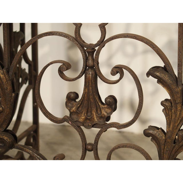 his fabulous 4 section wrought iron gate from France has beautiful scrolling motifs throughout, and it is in excellent...
