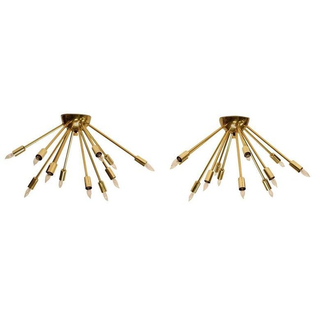 Mid-Century brass sputnik light fixture with 12 bulbs. Listed price is for each light. Only one is available.
