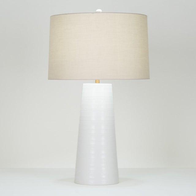 "30.5""H - 150W 3-way mouth-blown glass, white carved finish Shade: beige cotton; 17""ø(t) x 18""ø(b) x 11""H Handmade. Finish..."