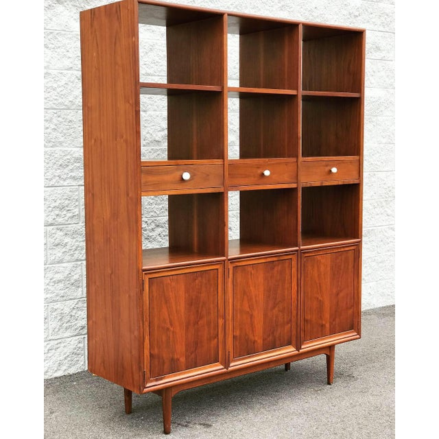 This Drexel Declaration wall unit designed by Kipp Stewart is in great condition. Made of solid walnut, this piece can...