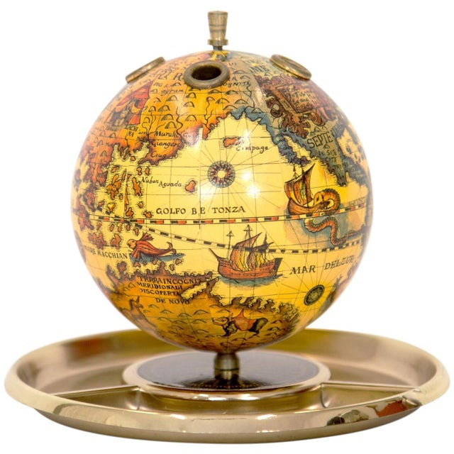 """Small-scale old world globe desk organizer. The 4.75"""" diameter globe has four pen or pencil holes and spins. The gold..."""