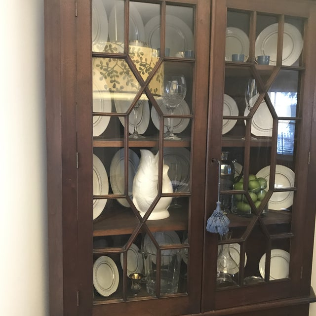 Traditional corner China cabinet. This was passed down from my grandparents, so am guessing it was made in the late 1800s