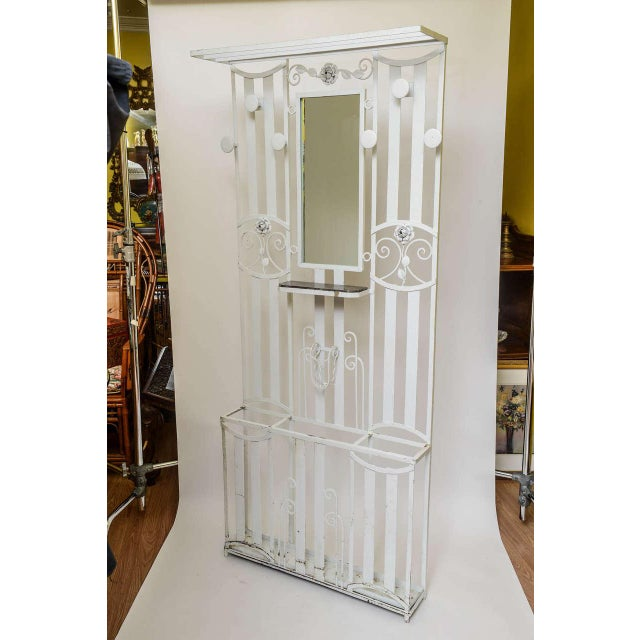 Art Deco French iron entry hall stand or tree with original marble inset shelf as well as original drip pan and appointed...