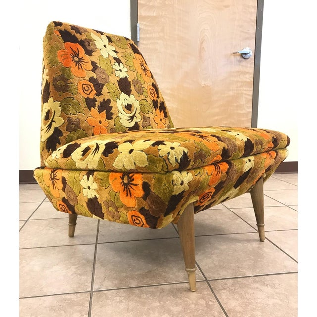 Mid-Century Modern Italian lounge chair armless lounge chair with original floral upholstery. Has wood legs with brass...