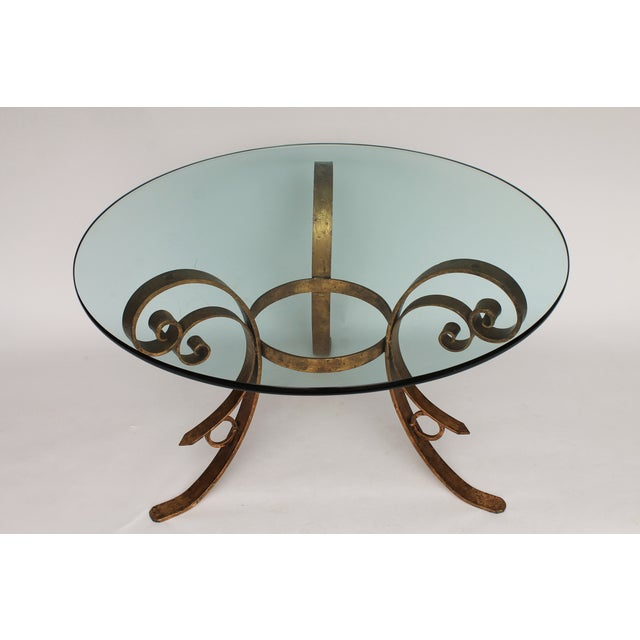 """Gilded scrolled dining table with circular glass top. No maker's mark. Some scratches to glass. Glass 3/4"""" thick."""
