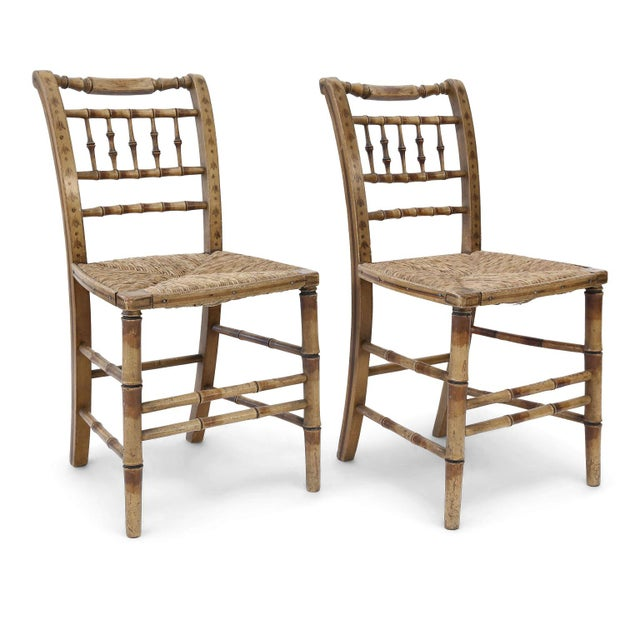 Pair of faux bamboo side chairs dating to the early-to-mid 19th century. Nice old painted finish in good condition....