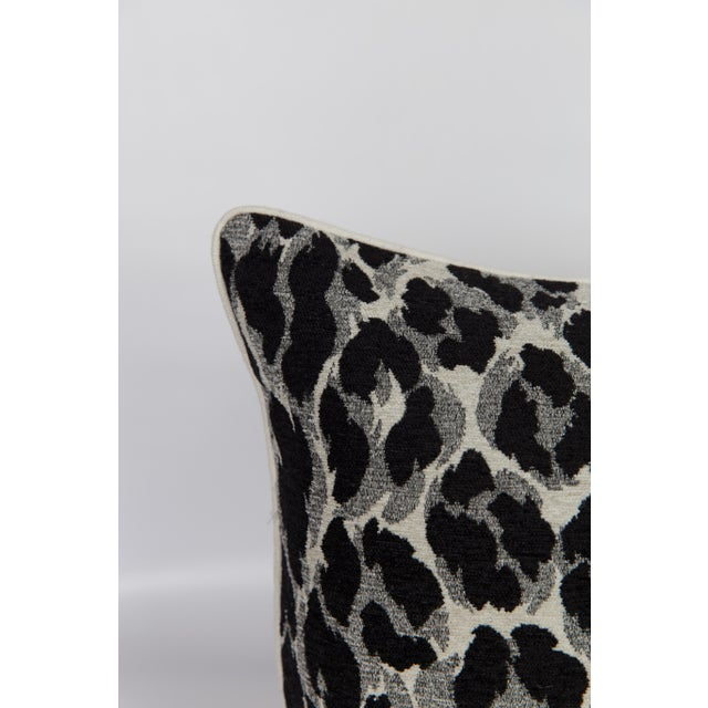Custom 14x30 lumbar pillow made from black, white and gray cheetah pattern chenille textile with a solid ivory velvet back...