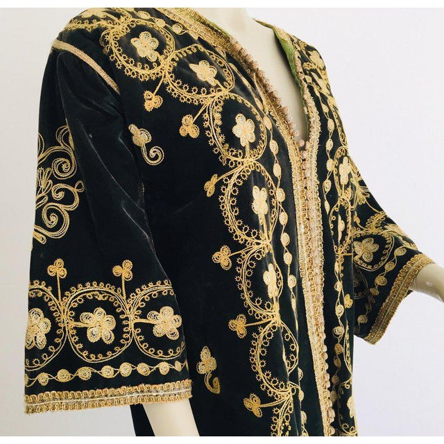 Amazing vintage caftan, black silk velvet heavily hand embroidered with gold threads, circa 1960s The black velvet kaftan...