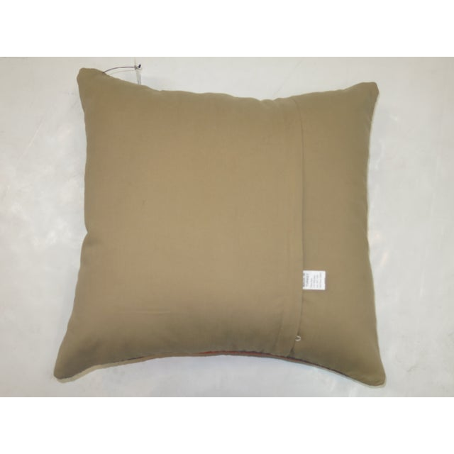 Pillow made from a antique turkish oushak rug with cotton back. Zipper closure and foam insert provided. 1'7'' x 1'7''.