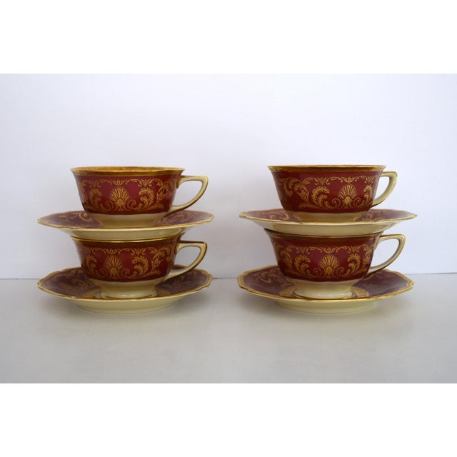 Vintage 1930s Cranberry red and Ivory tea cup and saucer set encrusted with gold. This listing is for a set of four cup...