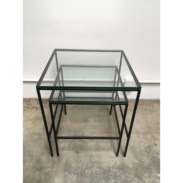 "Mid century modern black iron frame nesting tables in the manner of Paul Mccobb. Thick original 1/2"" glass tops with..."