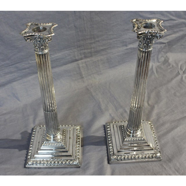 A grand pair of Corinthian column candlesticks. Old Sheffield Plate, c. 1780. Exceptional detail. Very good condition....