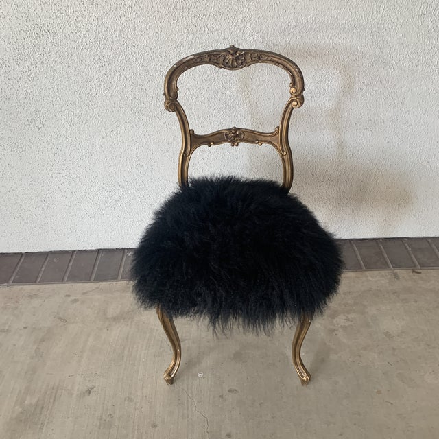 Beautiful and unique gilded side chair. Very glam and fun.
