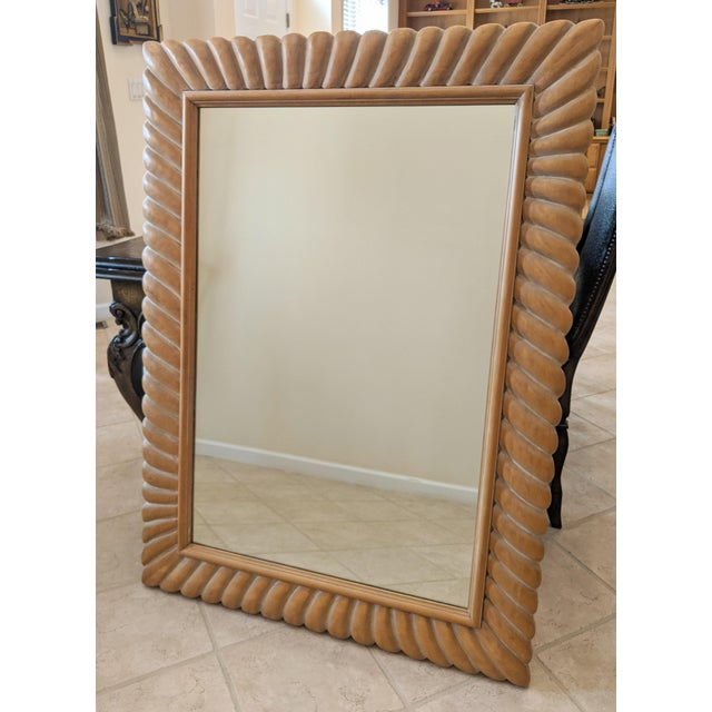 Mid 20th century Italian made natural wood tone carved solid wood mirror. Originally purchased at the D & D Building, NYC.