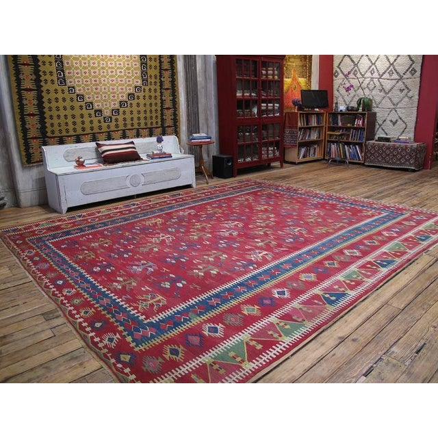 A finely woven antique kilim from the border region between present day Serbia and Bulgaria, centered around the town of...
