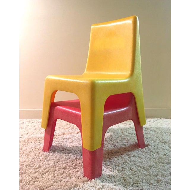 Pair of vintage 1970s kid's stacking chairs, made in Israel by Polyziv. In good vintage condition with minor scuffing, and...
