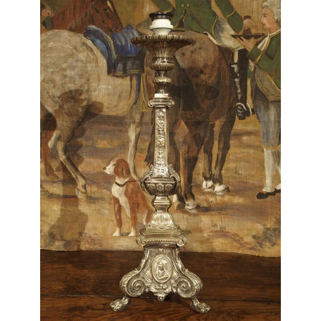 This antique French silver over bronze religious candlestick is in the Louis XIV Style. What is so significant about this...