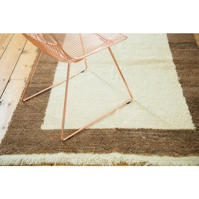 Simplistic and minimalistic Tulu rug with a thick main border. Colors and shades include ivory, milk chocolate brown....