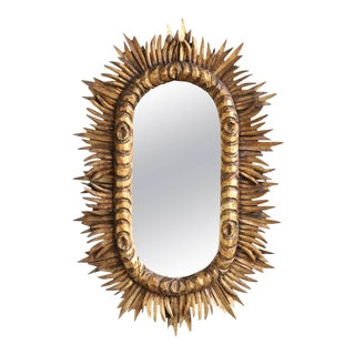 Spanish 1950s Giltwood Oval Sunburst Mirror For Sale