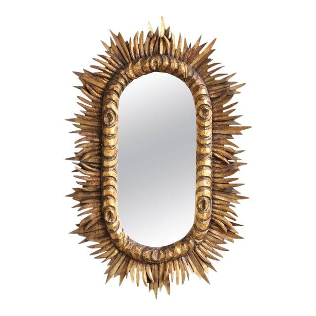 Spanish 1950s Giltwood Oval Sunburst Mirror For Sale