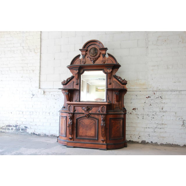 Offering a rare and outstanding monumental 19th century Victorian sideboard. The sideboard features fantastic carved wood...