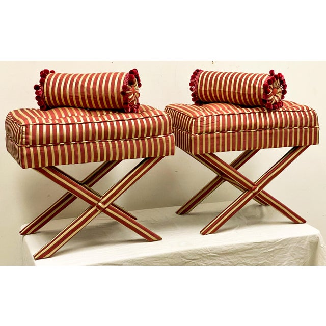 This is a vibrant pair of red striped upholstered x-benches in the manner of the late designer Mario Buatta. They include...