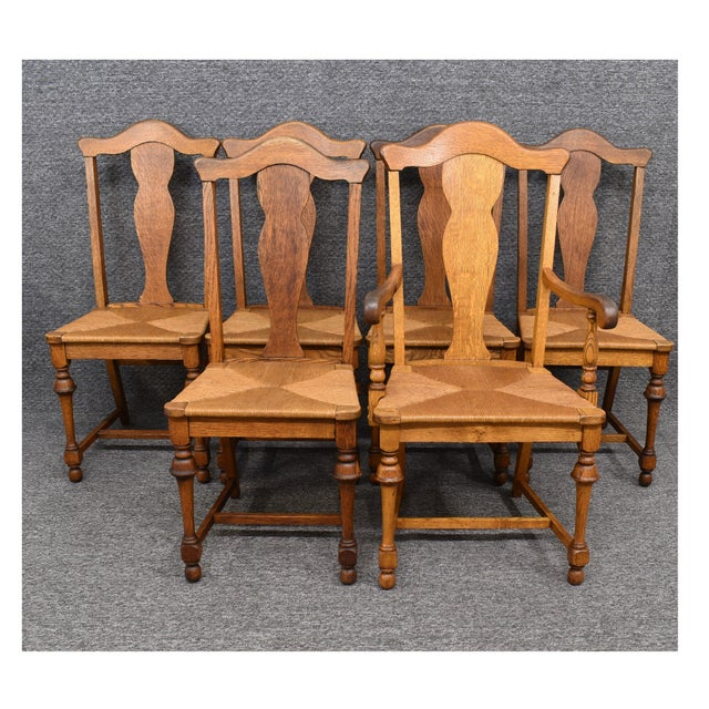 Vintage Tiger Oak Fiddle Back chairs with Rush Woven Seats Five Side Chairs/One Captain Chair. These chairs are crafted of...