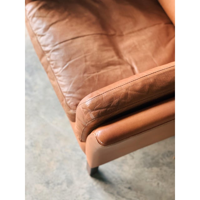 Stouby and feeling fine. Our vintage Stouby down filled club chair is your new reading chair. Upholstered in caramel...