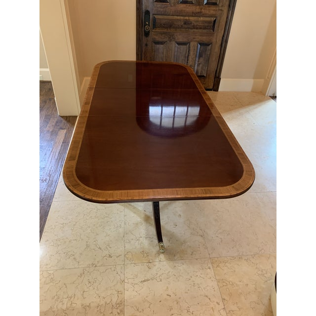"""Mahogany Council Craftsman Dining table. Double pedestal clawfoot. Note: 84 """" without leaves, (2) 20"""" leaves."""