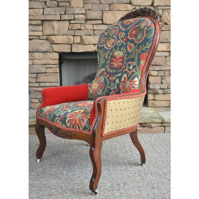 Antique Victorian Carved accent chair on original casters. Multicolor tapestry, bronze cathedral and red velvet...