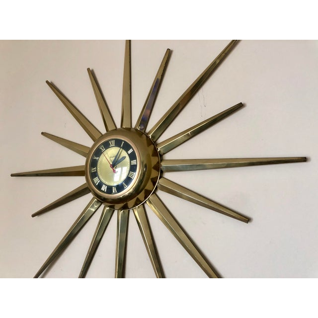 Mid century United brass starburst electric wall clock.