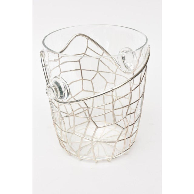 This absolutely stunning and sculptural signed Italian Pampaloni sterling silver and glass ice/ champagne bucket is...