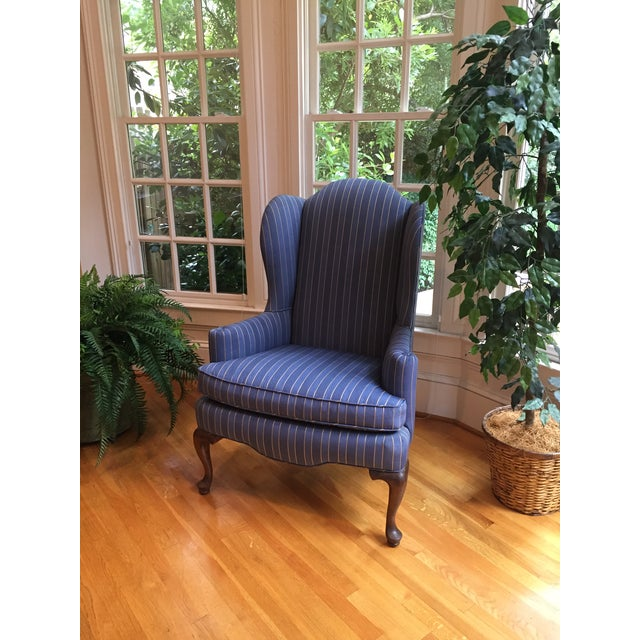 Blue with gold pin striped damask upholstered wingback chair with unique rolled and button tufted arm, and Queen Ann wood...