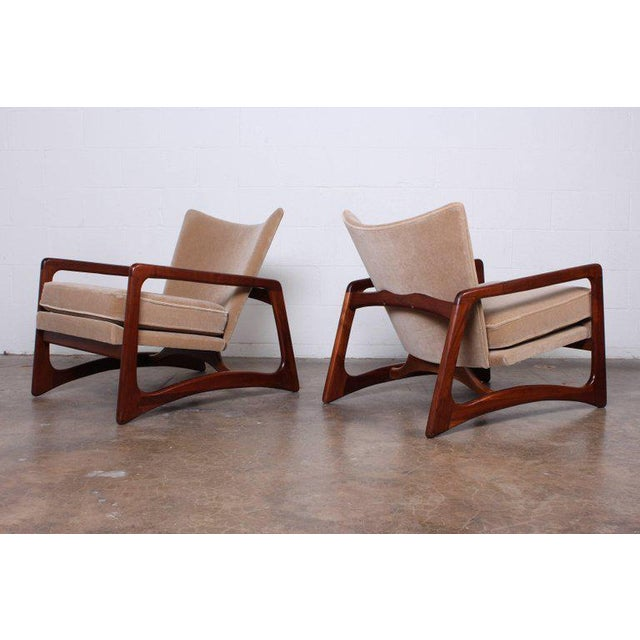 A pair of walnut and mohair lounge chairs by Adrian Pearsall for Craft Associates.