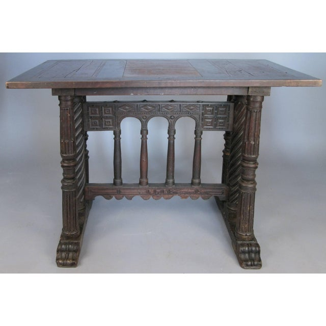 A Classic early 18th century Italian Arcadian base library table, with splendidly carved swirled fluted column supports...
