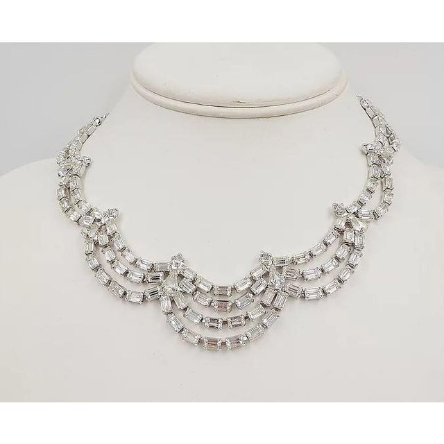 """1950s rhodium-plated baguette, teardrop, and round rhinestone festoon necklace. """"Marked Kramer of NY"""" Hook clasp. Marked..."""